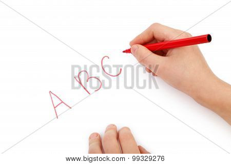 Childs Hands Writing Letters On White Paper
