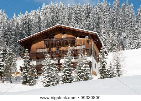 A Chalet On The Side Of A Mountain, Near The Village Of Warth-Schrocken, In Austria