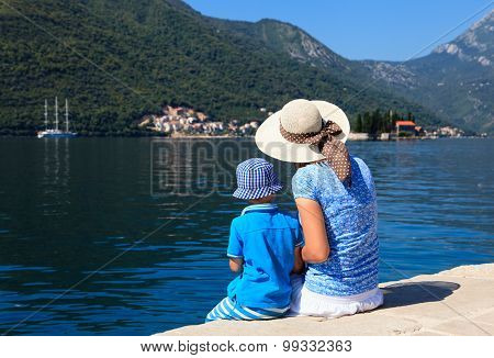 mother and son looking at scenic sea view