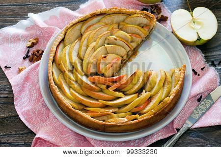 Apple Tart, Shortcrust Pastry Pie With Walnuts On A Wooden Background