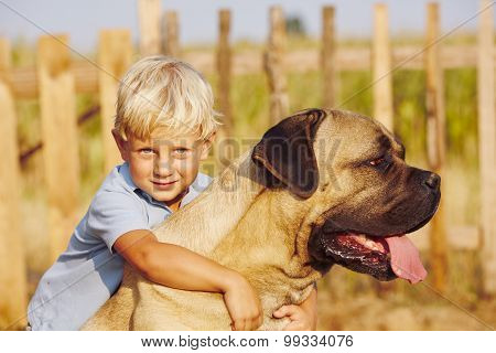 Little Boy With Large Dog