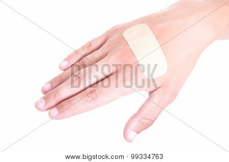 Close Up Of Adhesive Plaster On Male Hand