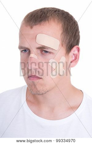 Injured Man With Adhesive Plaster On His Face