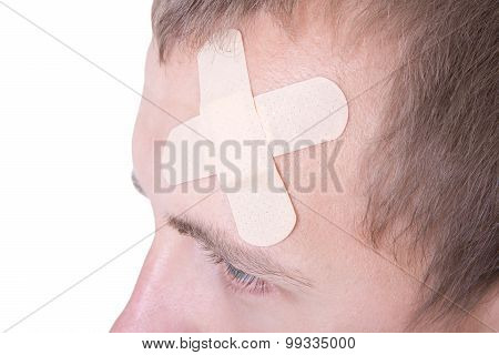 Close Up Of Adhesive Plaster On Male Forehead