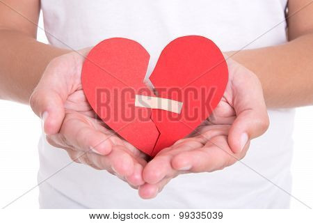 Divorce Concept - Man Holding Broken Heart With Plaster