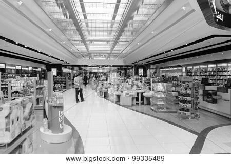 DUBAI, UAE - MARCH 31: duty free zone in airport. Dubai International Airport is an international airport serving Dubai. It is a major airline hub in the Middle East, and is the main airport of Dubai.