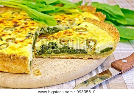 Pie with spinach on the tablecloth