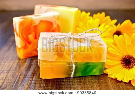 Soap homemade with calendula on board