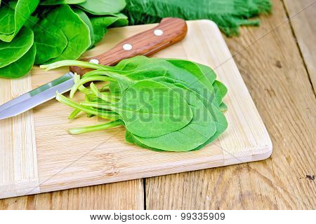 Spinach with knife on board