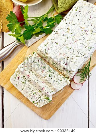 Terrine of curd and radish on paper and board top