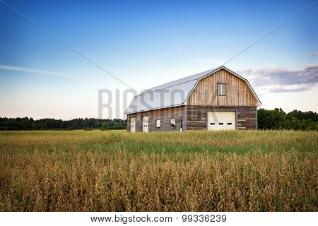 Wooden barn in Canadian countryside at dusk