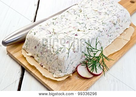 Terrine whole of curd and radish on paper and board