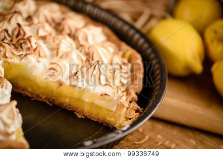 Lemon tart with toasted meringue top in french baking tin