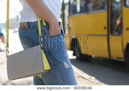 Young Woman Waiting For A Bus At The Bus Stop Close-up