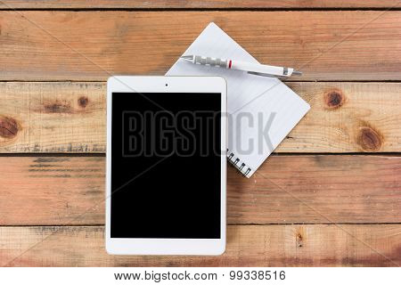 Tablet Device On Wooden Workspace Table