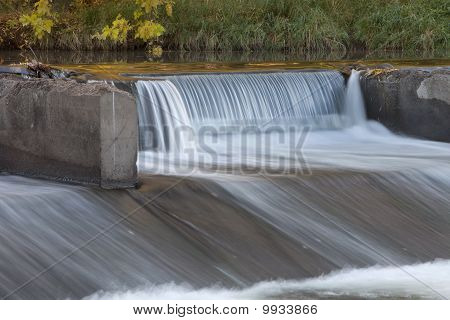 Old River Dam With Falling Water