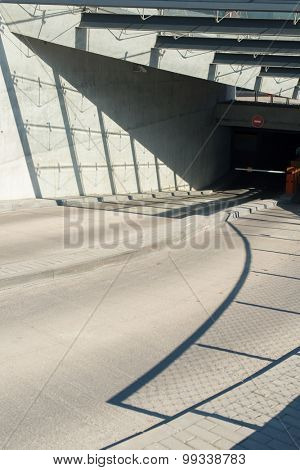 Abstract architectural forms and sharp shadows. Concrete garage entrance.
