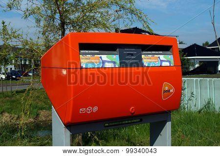 Bright orange Dutch PostNL mailbox