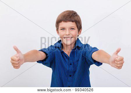 Portrait of happy boy showing thumbs up gesture