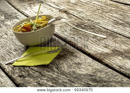 Delicious Frshly Cooked Italian Pasta With Pesto Genovese Sauce Served In A Beige Bowl And Decorated