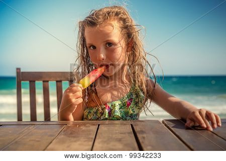 kid on table eating icecream