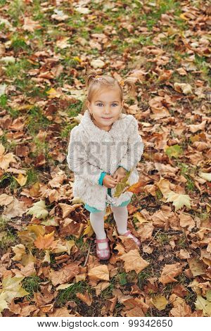 Cute Little Girl Holding Leaf In Hand