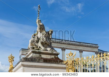 Statue Near The Entrance Of Palace Versailles In Paris, France