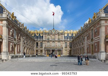 Visitors Walking At The Courtyard Palace Versailles Near Paris, France