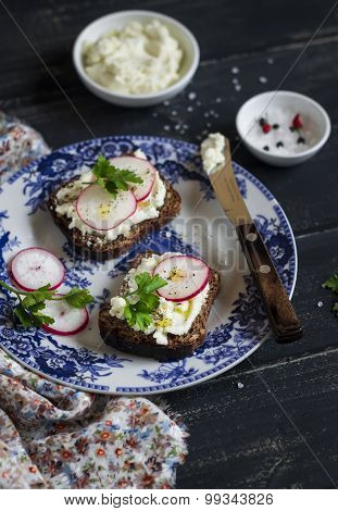 Sandwiches With Cream Cheese And Radish On A Vintage Plate On A Dark Wooden Background