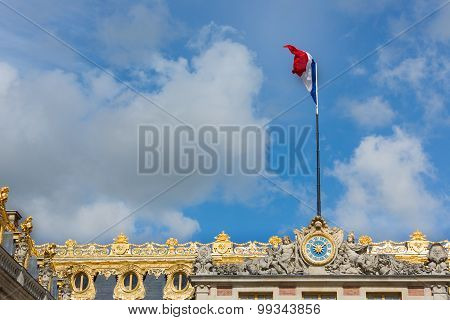 French Flag In Top Of Palace Versailles Near Paris