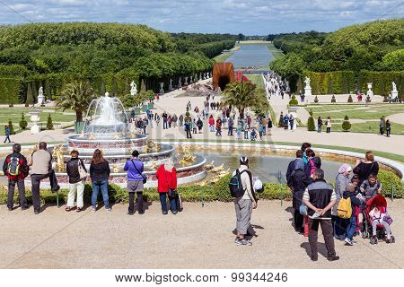 Visitors In Garden Palace Versailles In Paris, France