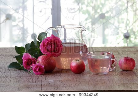 Apple Compote In A Transparent Jug, Apples And A Bouquet Of Roses