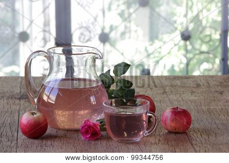 Apple Compote In A Transparent Jug Both Fresh Apples And A Rose