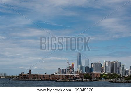 Downtown Manhattan Rizing Above Red Hook Warehouse