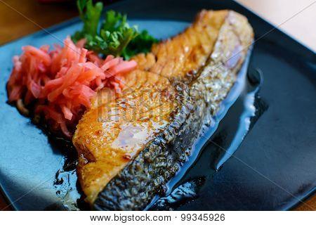 Salmon Steak And Ginger Preserves In  Black Dish