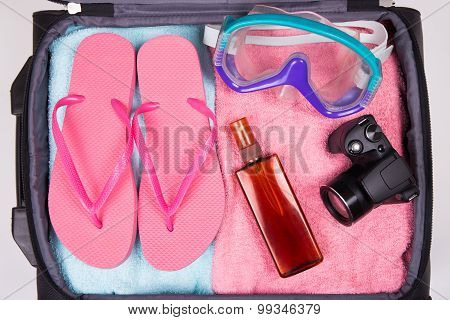 Summer Vacation Concept - Packed Suitcase Full Of Vacation Items