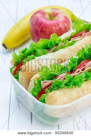 Lunch Box With Ciabatta Bread Sandwiches, Apple and Banana