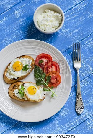 Toast With Feta Cheese And Fried Quail Egg, Fresh Tomatoes On A  Wooden Surface - A Healthy Breakfas
