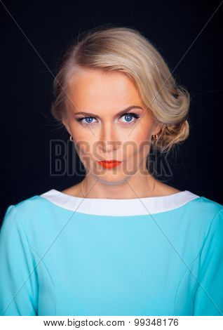 close up portrait of beautiful young model isolated on black background