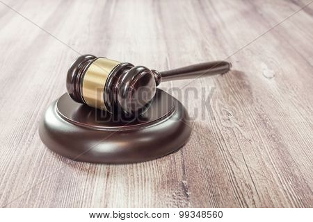 judge gavel on the brown wooden table,justice
