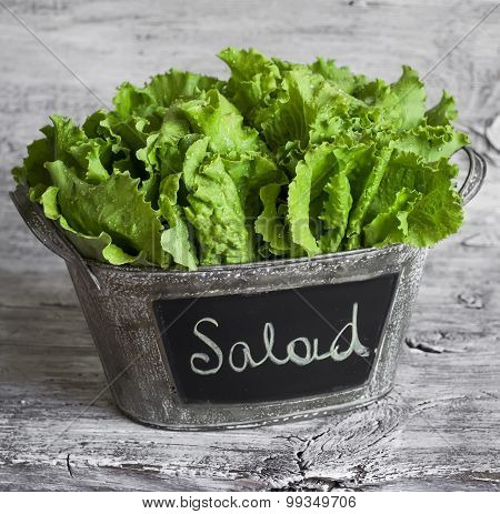 Fresh Green Salad In A Vintage  Bucket On Light Wooden Surface