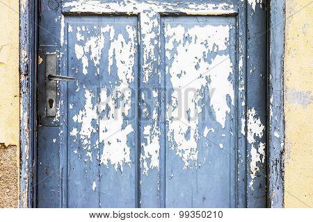 Blue Door With Peeling Paint