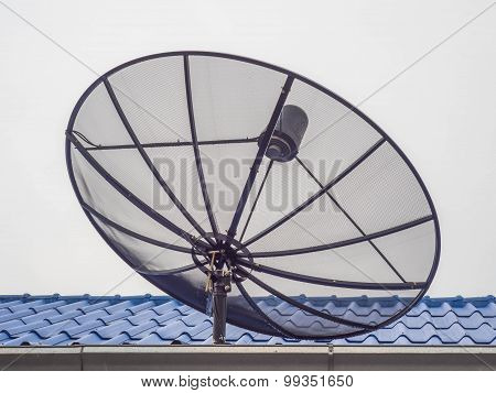 Black Satellite Dish On The Blue Roof.