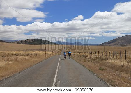Cyclist along a deserted road