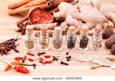 Assortment Of Thai Food Cooking Ingredients In Glass Bottles On Wooden Background.