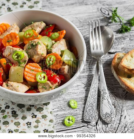 Meat Stew With Vegetables - Carrots, Onions And Sweet Peppers In A White Bowl On A Light Wooden Back
