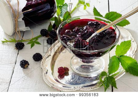 Blackberries, Canned In Juice Cans On A Wooden Table