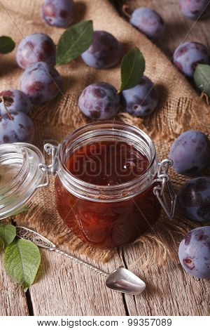 Homemade Plum Confiture In A Glass Jar Close-up. Vertical Top View