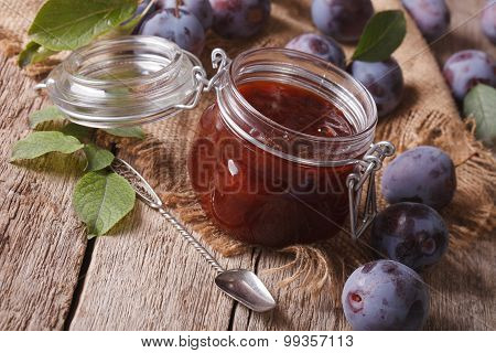 Homemade Plum Marmalade In A Glass Jar. Horizontal