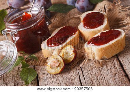 Homemade Plum Jam And Sandwiches Close-up. Horizontal